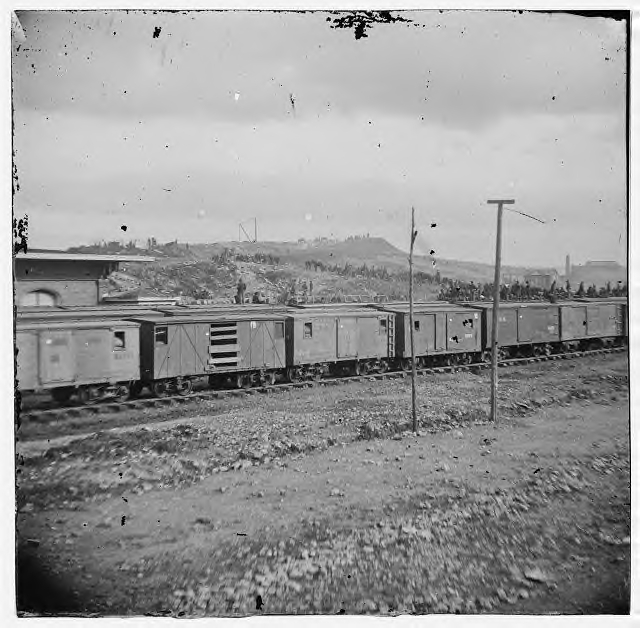 "Box cars. Notice the ventilation ""windows"" and the car with its door missing."